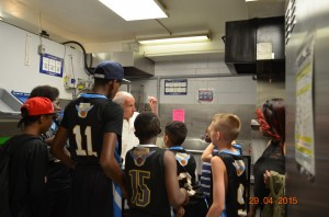Team receives a tour of the actual soup kitchen from the manager.
